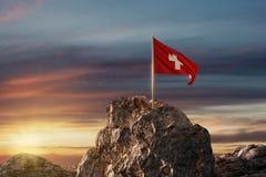 rendu 3d d'onduler le drapeau suisse sur le paysage rocheux au celebrat illustration de vecteur