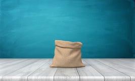 rendu 3d d'un sac ouvert d'argent fait de tissu hessois sans des inscriptions se tenant sur un bureau en bois sur le fond bleu Photo stock