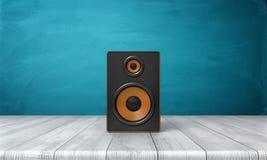 rendu 3d d'une boîte un noire de haut-parleur avec l'équilibre orange se tenant sur une table en bois devant un fond bleu Photo libre de droits
