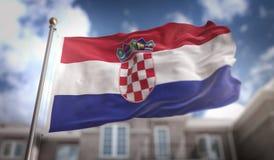 Rendu du drapeau 3D de la Croatie sur le fond de bâtiment de ciel bleu Photographie stock libre de droits