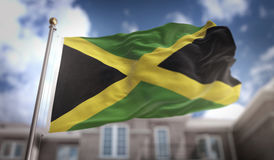 Rendu du drapeau 3D de la Jamaïque sur le fond de bâtiment de ciel bleu Photo stock