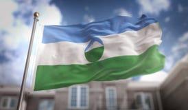 Rendu du drapeau 3D de la Kabardino-Balkarie sur le ciel bleu construisant Backgr Photographie stock libre de droits
