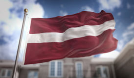 Rendu du drapeau 3D de la Lettonie sur le fond de bâtiment de ciel bleu Photo libre de droits