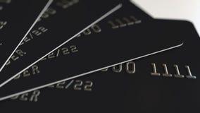 Rendu en plastique noir des cartes de crédit 3D Images stock