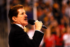Rene Rancourt sings the National Anthem. Royalty Free Stock Image