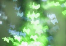 Renen formad bokeh tänder i gräsplan och blått Royaltyfria Foton