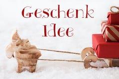 Renen med släden på snö, Geschenk Idee betyder gåvaidé Fotografering för Bildbyråer