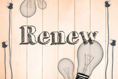 Renew against light bulb on wooden background Stock Photo