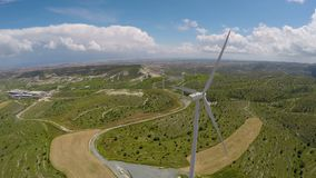 Renewable alternative energy generation in Cyprus, aerial view of windmill farm. Stock footage stock footage