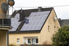 Renewable clean green energy saving efficient solar panels on  s. Uburban house roof Royalty Free Stock Photo