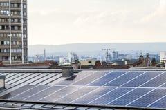 Renewable clean green energy saving efficient solar panels on  s. Uburban house roof Stock Photos