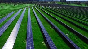 Renewable electric power station with solar panels. Drone view of solar farm. Renewable electric power station with solar panels. Drone view of photovoltaic stock footage