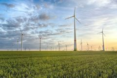 Renewable energies - power generation with wind turbines in a wi. Nd farm stock images