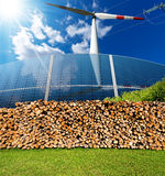Renewable Energies Sources - Wind Solar Biomass. Renewable energies sources - Wind energy wind turbine, Solar energy solar panels, biomass Firewood logs and a Stock Images