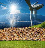 Renewable Energies Sources - Wind Solar Biomass. Renewable energies sources - Wind energy wind turbine, Solar energy solar panels, biomass Firewood logs and a Royalty Free Stock Photo