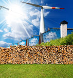 Renewable Energies Sources - Wind Solar Biomass. Renewable energies sources - Wind energy wind turbine, solar energy roofs of houses with solar panels, biomass Royalty Free Stock Image