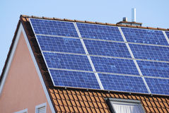 Renewable energy. House with solar panels for renewable energy production Royalty Free Stock Photos
