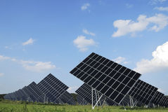 Renewable energy. With huge solar panels Royalty Free Stock Images