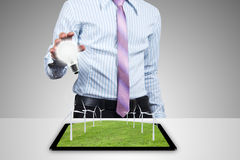 Renewable energy. Renewable energy from Wind turbines on the tablet Royalty Free Stock Image
