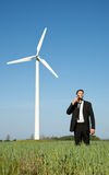 Renewable energy. Businessperson on meadow as symbol of ecological use of renewable energy stock photography
