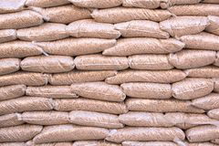 Renewable energy- biomass. Eco pellets- biomass in bags royalty free stock photography