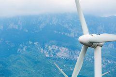 Renewable energy closeup. Wind power generation with cliff background Royalty Free Stock Photography