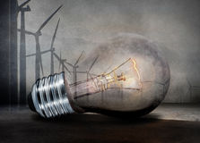 Renewable energy concept. Electric bulb and windmill generators Stock Photography