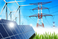 Renewable energy concept with grid connections solar panels and wind turbines. And blue sky background royalty free stock photo