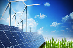 Renewable energy concept with solar panels and wind turbines on green field royalty free stock images