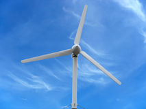 Renewable Energy Concept Wind turbine over blue sky background Royalty Free Stock Images