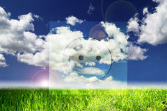 Renewable energy concepts. Perfect landscape with electric plug overlay Stock Photo