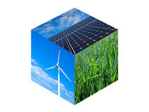 Renewable Energy Cube. Wind turbine, solar panels and wheat field. Renewable energy photos in a cube Royalty Free Stock Photo
