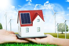 Renewable energy future for domestic consumption concept with miniature house and natural sources of energy royalty free stock image