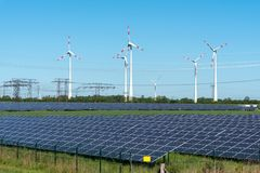 Renewable energy generation and power transmission lines. Seen in Germany Royalty Free Stock Photo