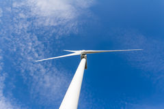 Renewable energy generation with wind turbine royalty free stock images