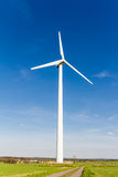 Renewable energy generation with wind turbine royalty free stock photo