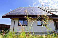 Renewable energy house with photovoltaic roof Royalty Free Stock Photo
