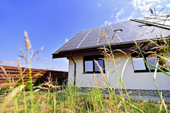 Renewable energy house with photovoltaic roof Royalty Free Stock Photography