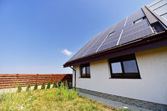Renewable energy house with photovoltaic roof Stock Image