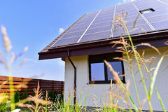 Renewable energy house with photovoltaic roof Royalty Free Stock Images