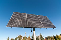 Renewable Energy - Photovoltaic Solar Panel Array. A photovoltaic solar panel array in a park with a blue sky in the background Royalty Free Stock Photography