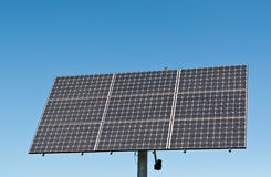 Renewable Energy - Photovoltaic Solar Panel Array. A photovoltaic solar panel array in a park with a deep blue sky in the background. Clean, renewable energy Royalty Free Stock Photos