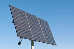 Renewable Energy - Photovoltaic Solar Panel Array. A photovoltaic solar panel array in a park with a deep blue sky in the background. Clean, renewable energy Royalty Free Stock Photography