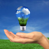 Renewable Energy is Within Reach. Hand Holding Lighbulb Concept of Clean Renewable Energy of the Future stock photography