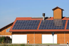 Renewable energy on the roof. Solar panels to generate electricity Stock Images