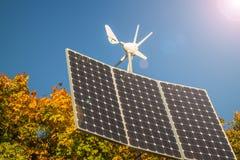 Renewable energy, solar panel. Small private Solar panels and rotor, Renewable energy Stock Photo