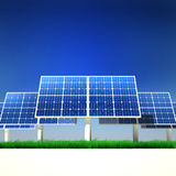 Renewable Energy - Solar Panels. Solar panels on a green grass field on a clean sky background Stock Photo