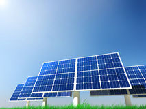 Renewable Energy - Solar Panels. Solar panels on a green grass field on a clean sky background Royalty Free Stock Photography