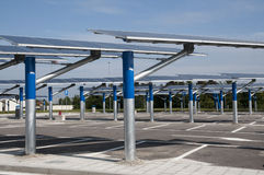 Renewable energy: solar panels. In a parking lot of a highway Italian. A solar panel (photovoltaic module or photovoltaic panel) is a packaged interconnected Royalty Free Stock Photo