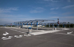 Renewable energy: solar panels. In a parking lot of a highway Italian. A solar panel (photovoltaic module or photovoltaic panel) is a packaged interconnected Royalty Free Stock Photography